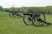 stock photo of revolutionary war  - Several revolutionary war military cannons on battlefield - JPG