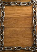 metal chain on wooden background