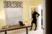 Pregnant business woman entering her home office