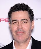 LOS ANGELES - NOV 19:  Adam Carolla arrives to the Jaguar F-TYPE Global Reveal Event  on November 19