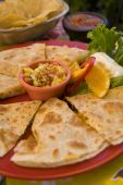 stock photo of senorita  - A favorite Mexican snack dressed up with chicken and mango salsa - JPG