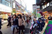 Tokyo - Nov 24 : People, Mostly Youngsters, Walk Through Takeshita Dori Near Harajuku Train Station