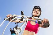 Female Biker Starting To Ride With Blue Sky Background