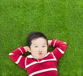 A Spoof Expression Kid Lying And Holding His Head