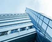 Panoramic and perspective wide angle view to steel blue background of glass high rise building skysc