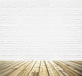 Background of an old natural wooden darken brown floor with messy and grungy textured white brick an