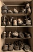 picture of hackney  - Toned image of an old wooden shoes box with a lot of different footwear inside - JPG