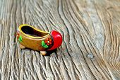 Traditional Turkish Single Clog With Atractive Style And Colorful On A Wooden Table