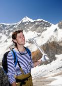 stock photo of bagpack  - Young mountaineer with bagpack and ice - JPG