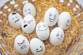 foto of angry smiley  - Easter eggs with different facial expressions in basket - JPG