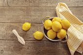 Fresh lemons on wooden counter top