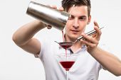 stock photo of bartender  - bartender preparing cocktail with bar equipment - JPG