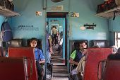 HIKKADUWA, SRI LANKA - MARCH 12, 2014: Commuters sitting in train to Colombo. Trains are very cheap