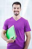 Teenage student with folders