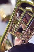 foto of trombone  - Close up detail of a trombone being played in a marching band - JPG