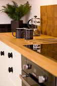 Coffee Mugs In Modern Designer Kitchen