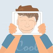 Guy holds tablet pc displaying fun smiling drawing