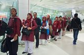 DOHA, QATAR - FEBRUARY 18, 2014: Passengers wait in check-in line at Doha International Airport, the only commercial airport in Qatar.