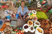 HIKKADUWA, SRI LANKA - FEBRUARY 23, 2014: Portrait of elderly man selling produce. The Sunday market is great way to see Hikkaduwa's local life come alive along with fresh produce and local delicacy