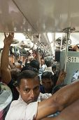 HIKKADUWA, SRI LANKA - FEBRUARY 22, 2014: Crowded commuter train to Colombo. Trains are very cheap a