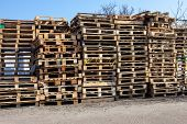The Big Stack Of Wooden Cargo Pallets