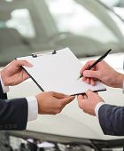 pic of rental agreement  - Signing a car car sale agreement - JPG