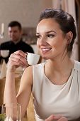Smiling Woman Drinking Espresso