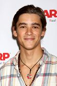 LOS ANGELES - AUG 1:  Brenton Thwaites at the AARP Luncheon IHO Jeff Bridges at the Spago on August