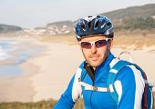 Cyclist In Nature Looking At Camera