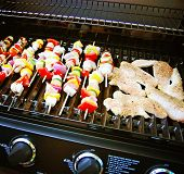 a brand new grill with meat and vegetables on it