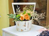 Flower arrangement in white vintage pot. Wedding decoration with yellow flowers. Yellow gerberas