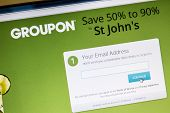 Ostersund, Sweden -August 2, 2014: Groupon website on a computer screen. Groupon is a deal-of-the-day website that features discounted gift certificates usable at local or national companies.