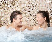 Happy Couple In A Jacuzzi poster