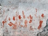Bloody hands painted on old wall