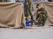 Children Play With Weapons On Army Day