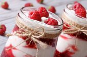 Fresh Raspberry Yogurt In A Glass Jar Closeup Horizontal