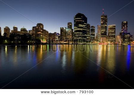 poster of city skyline at dusk by river