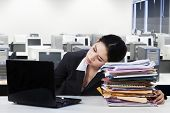 Female Employee Sleeps In Office
