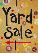 stock photo of yard sale  - brightly painted color cardboard yard sale sign - JPG