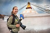 Tourist With Lonely Planet Guide In Nepal