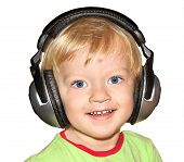 Small Child Listens To Music In The Headphones Isolated On A White Background