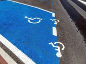 parking for wheelchair users. disabled parking in a city.