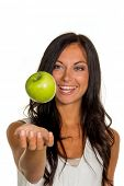 a young woman holding an apple in his hand. fruits and vegetables for healthy, vitamin-rich diet