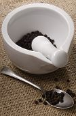 Mortar And Pestle With Pepper