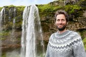 picture of yoke  - Man in Icelandic sweater by waterfall on Iceland - JPG