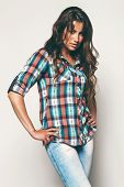 Pretty Woman In Check Shirt And Blue Jeans