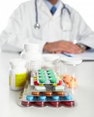Doctor writing medical prescription. Health care Pharmaceutical background