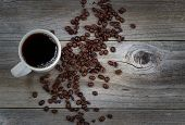 Dark Coffee And Beans On Rustic Wood With Slight Vignette Border
