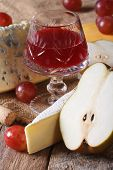 Red Wine With Cheese And Fruit Close-up Vertical