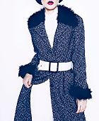 Brunette Model In Fashionable Coat On A White Background